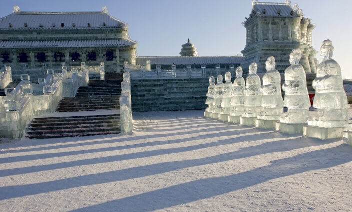 Forbidden Palace ice sculpture at sunset during Ice Festival in Harbin, China