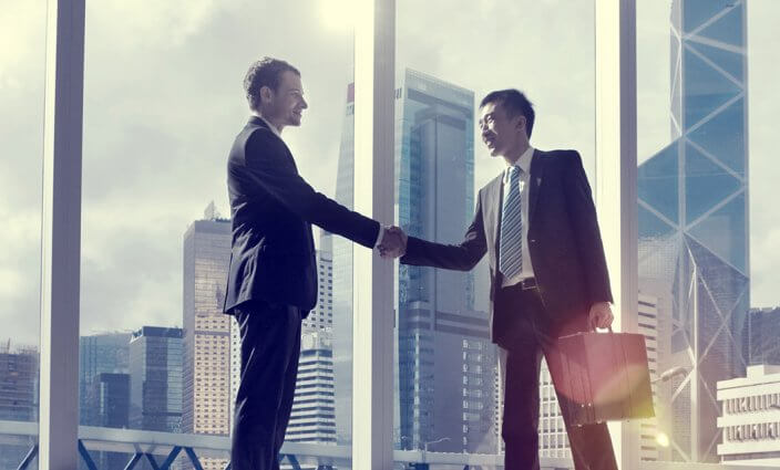 Asian Business Handshake Agreement Partnetship Concept