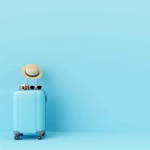Koffer und Reise planen